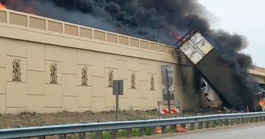 Smoke billows from a semi after a deadly crash on Interstate 94 in Caledonia, Wis, Wednesday, June 19, 2019. Authorities said the semi crashed and exploded and ignited other vehicles on the interstate in southeastern Wisconsin.
