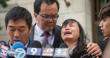 Lifeng Ye, the mother of slain University of Illinois scholar Yingying Zhang, cries out in grief as her husband Ronggao Zhang, far left, addresses the media after a jury found Brendt Christensen guilty of her murder Monday, June 24, 2019 outside the U.S.