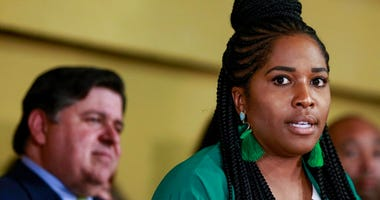Rep. Jehan Gordon-Booth, D-Peoria speaks during a news conference before Gov. J. B. Pritzker signs a bill that legalizes adult-use cannabis in the state of Illinois at Sankofa Cultural Arts and Business Center, Tuesday, June 25, 2019, in Chicago.