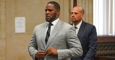 In this June 6, 2019, file photo, singer R. Kelly pleaded not guilty to 11 additional sex-related felonies during a court hearing before Judge Lawrence Flood at Leighton Criminal Court Building in Chicago.