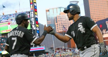Chicago White Sox's Tim Anderson, left, congratulates Jose Abreu on Abreu's two-run home run off Minnesota Twins pitcher Michael Pineda in the third inning of a baseball game Tuesday, Aug. 20, 2019, in Minneapolis