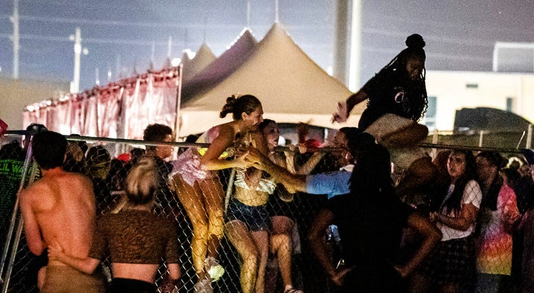 Festival-goers try to escape the crowd during Lil Wayne's fifth annual Lil WeezyAna Fest at the UNO Lakefront Arena grounds in New Orleans.