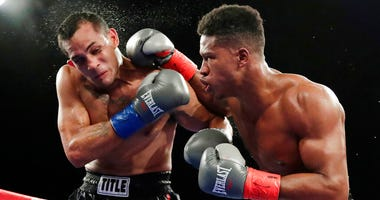 In this Oct. 27, 2018, file photo, Patrick Day, right, punches Elvin Ayala during the fifth round of a WBC super welterweight boxing bout in New York.