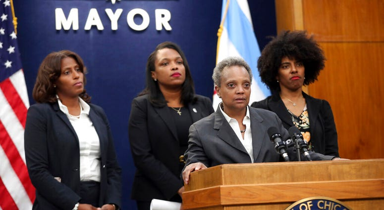 Mayor Lori Lightfoot, joined by Chicago Public Schools CEO Janice Jackson, rear center, makes a statement about the Chicago Teachers Union strike Tuesday, Oct. 29, 2019, at City Hall in Chicago.