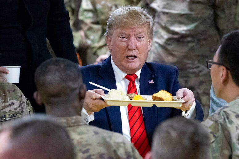 President Donald Trump speaks with members of the military during a surprise Thanksgiving Day visit, Thursday, Nov. 28, 2019, at Bagram Air Field, Afghanistan.