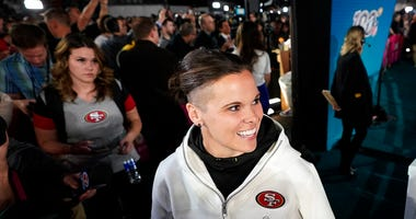 San Francisco 49ers assistant coach Katie Sowers speaks to reporters during Opening Night for the NFL Super Bowl 54 football game Monday, Jan. 27, 2020, at Marlins Park in Miami.