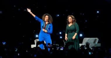 Michelle Obama, Oprah Winfrey headline arena like rock stars