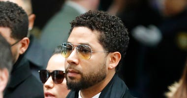 "Former ""Empire"" actor Jussie Smollett, center, arrives for an initial court appearance Monday, Feb. 24, 2020, at the Leighton Criminal Courthouse in Chicago"