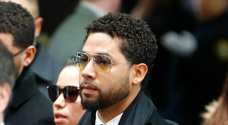 """Former """"Empire"""" actor Jussie Smollett, center, arrives for an initial court appearance Monday, Feb. 24, 2020, at the Leighton Criminal Courthouse in Chicago"""