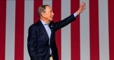 Democratic presidential candidate Mike Bloomberg waves to supporters as he arrives to his campaign rally at the Palm Beach County Convention Center in West Palm Beach, Fla., Tuesday, March 3, 2020.