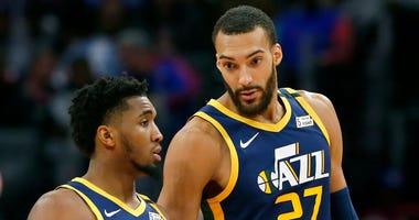 Utah Jazz center Rudy Gobert (27) talks with guard Donovan Mitchell