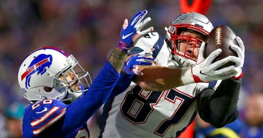 New England Patriots tight end Rob Gronkowski, right, makes a catch next to Buffalo Bills defensive back Phillip Gaines during the second half of an NFL football game in Orchard Park, N.Y.