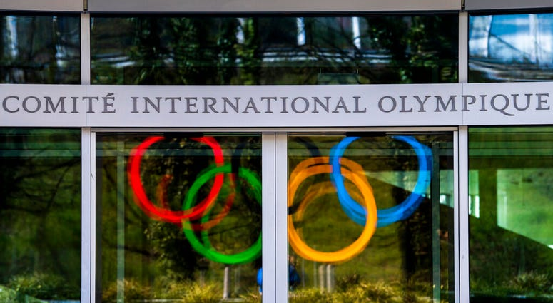 The Olympic Rings are displayed at the entrance of the IOC, International Olympic Committee headquarters during the coronavirus disease (COVID-19) outbreak in Lausanne, Switzerland, Tuesday, March 24, 2020.