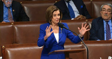 In this image from video, House Speaker Nancy Pelosi of Calif., speaks on the floor of the House of Representatives at the U.S. Capitol in Washington, Friday, March 27, 2020.
