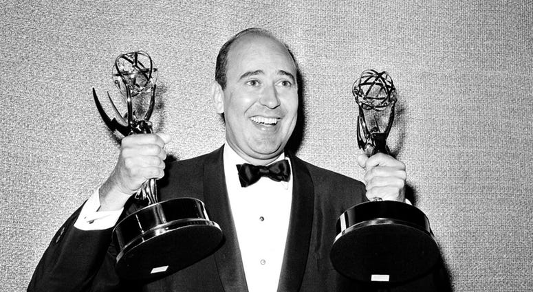 """In this May 26, 1963 file photo, Carl Reiner shows holds two Emmy statuettes presented to him as best comedy writer for the """"Dick Van Dyke Show,"""" during the annual Emmy Awards presentation in Los Angeles."""