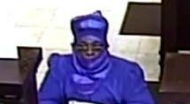 Surveillance image of the suspect in a bank robbery Aug. 15, 2019, at the Wintrust Bank at 7555 N. Western Ave.