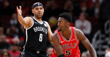 Bulls forward Bobby Portis (5) is defended by Nets forward Jared Dudley.