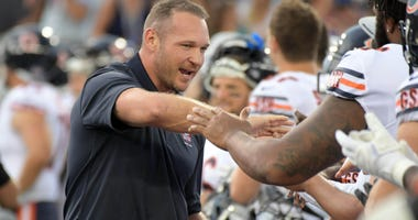 Hall of Fame enshrinee Brian Urlacher is greeted by Bears players ahead of the Hall of Fame Game.