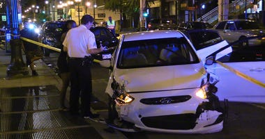 Chicago police investigate the scene where an attempted carjacking was thwarted by the victims in the back seat , Tuesday night, in the 300 block of South Dearborn.