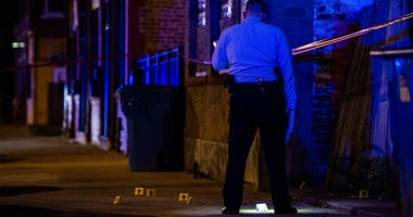 Chicago Police investigate the scene where two people were shot, Thursday night, in the 3500 block of West Cermak, in the Little Village neighborhood.