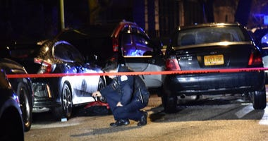 Chicago police investigate after a man was shot and critically wounded while driving Feb. 9, 2020, in the 2800 block of North Campbell Avenue in Avondale.