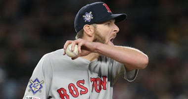 Chris Sale of the Boston Red Sox wipes his face during a start against the New York Yankees.