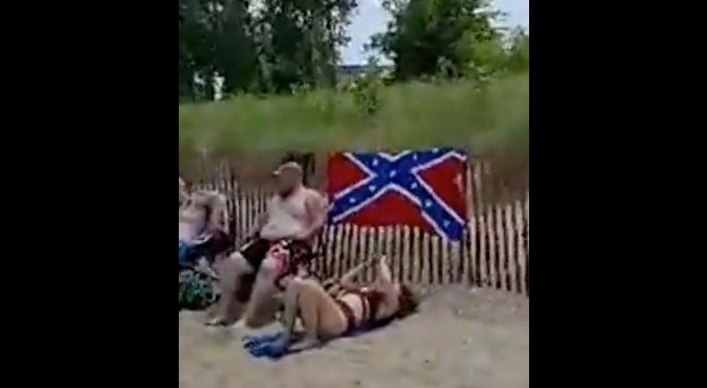 An Evanston woman's video has gone viral after she went to a beach in her city and confronted people who were displaying the Confederate flag.