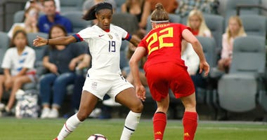 Crystal Dunn of the United States women's soccer team takes on a defender during a friendly match against Belgium.