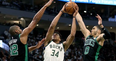 Al Horford and Jayson Tatum of the Boston Celtics contest a shot by the Milwaukee Bucks' Giannis Antetokounmpo during Game 1 of the Eastern Conference semifinals.