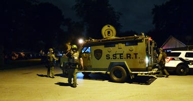 Police in heavy gear could be seen outside a residential home Wednesday evening in Dolton.