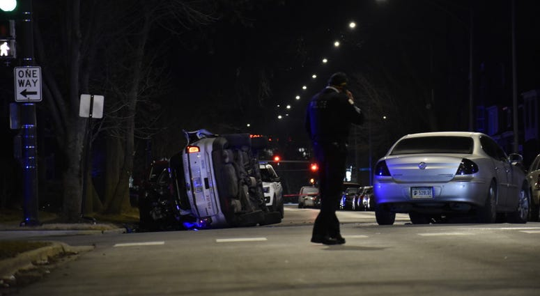 Two Chicago police officers were hurt in a rollover crash when another vehicle collided with a squad car Feb. 3, 2020, at 85th Street and Yates Boulevard.