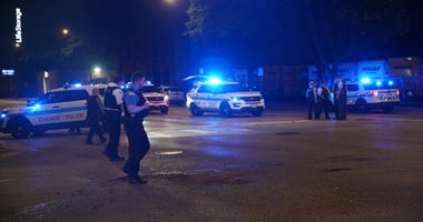 Chicago police gather at the intersection of Western Avenue and Fulton Street, where a police vehicle was rear-ended June 25, 2019.