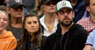 Danica Patrick and Aaron Rodgers take in the Milwaukee Bucks' Game 5 win over the Boston Celtics.