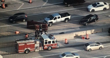 A group of good Samaritans helped pull the driver out of a pickup that rolled over Monday on the Reagan Memorial Tollway in west suburban Oak Brook.