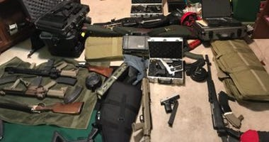 Two people are in custody Friday after police discovered a stash of guns at a home in Lawndale on the West Side.
