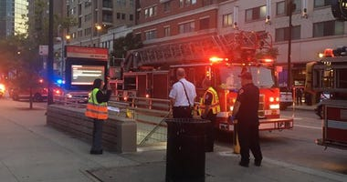 Red Line trains are being diverted Friday after a person was fatally struck by a train, and two others were injured in the South Loop, authorities said.
