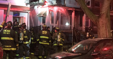 Crews were battling the blaze about 11:45 p.m. at a residence in the 1600 block of North Spaulding Avenue, according to Chicago Fire Department officials.