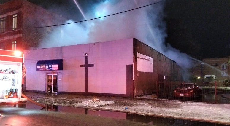 Crews work to extinguish a fire at Cedar Grove Missionary Baptist Church in Englewood on Nov. 14, 2019.