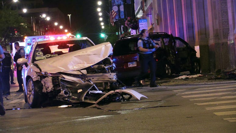 Chicago police investigate the scene of a multi-vehicle crash with ejection, Thursday morning, at the intersection of Halsted and Madison, in the West Loop neighborhood.