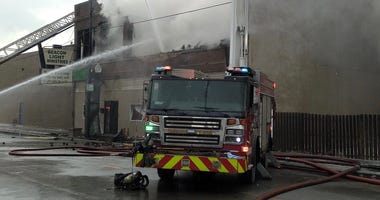 Firefighters work to extinguish a fire Jan. 20, 2020, at 11034 S. Michigan Ave.