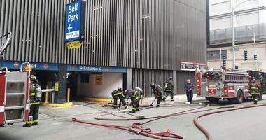 Crews extinguished a car fire Feb. 24, 2020, in a parking garage at 10 E. Ontario St.