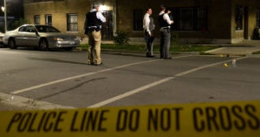 Police investigate a shooting about 11:30 p.m. Friday, July 27, 2018 in the 1100 block of South Troy Ave in Chicago.