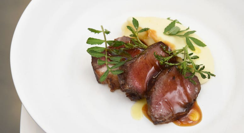A view of the Roasted New Zealand Lamb by James Beard Award Winning Chef and restaurateur David Chang, during an immersive culinary experience hosted by American Express Travel and David Chang, at Lightbox on November 14, 2018 in New York City.