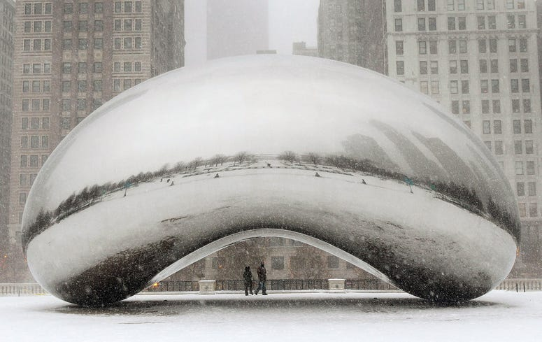 Snow falls on the Cloud Gate sculpture in Millennium Park on February 1, 2011 in Chicago