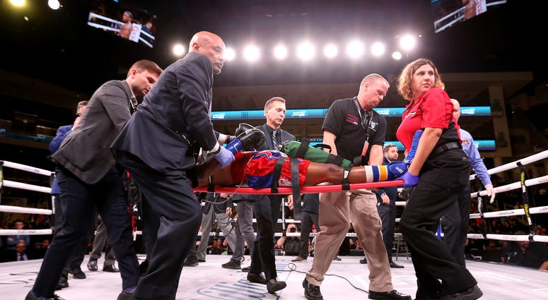 Patrick Day is taken out of the ring after being knocked out in his Super-Welterweight bout against Charles Conwell at Wintrust Arena on October 12, 2019 in Chicago, Illinois.