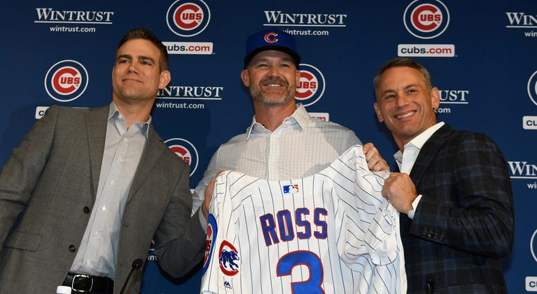 Theo Epstein, president of baseball operations of the Chicago Cubs, (L) David Ross, new manager of the Chicago Cubs (C) and Jed Hoyer, general manager of the Cubs (R) pose for a photo as Ross is introduced to the media at Wrigley Field on October 28, 2019