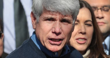 With his wife Patti by his side, former Illinois Governor Rod Blagojevich speaks during a press conference in front of his home on February 19, 2020 in Chicago, Illinois.