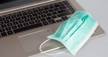 Medical breathing mask on laptop
