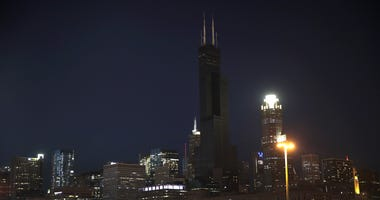 The Willis Tower rises above the downtown skyline as a blackened mass after flooding caused by recent heavy rains knocked out power to the building Monday on May 20, 2020 in Chicago, Illinois.