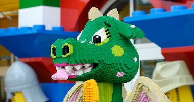 An interactive girl dragon named Bubbles takes a bath on the patio as she playfully sprays water and speaks to young guests of North America's first ever Legoland Hotel at Legoland on September 17, 2013 in Carlsbad, California.